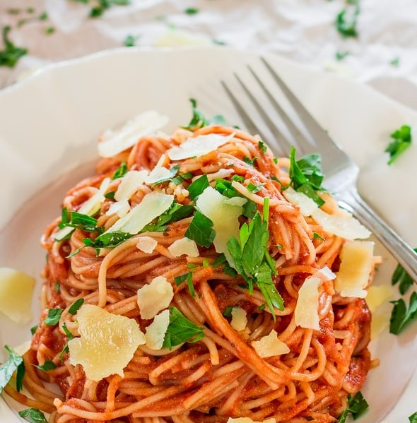 a plate of spaghettini in blush sauce