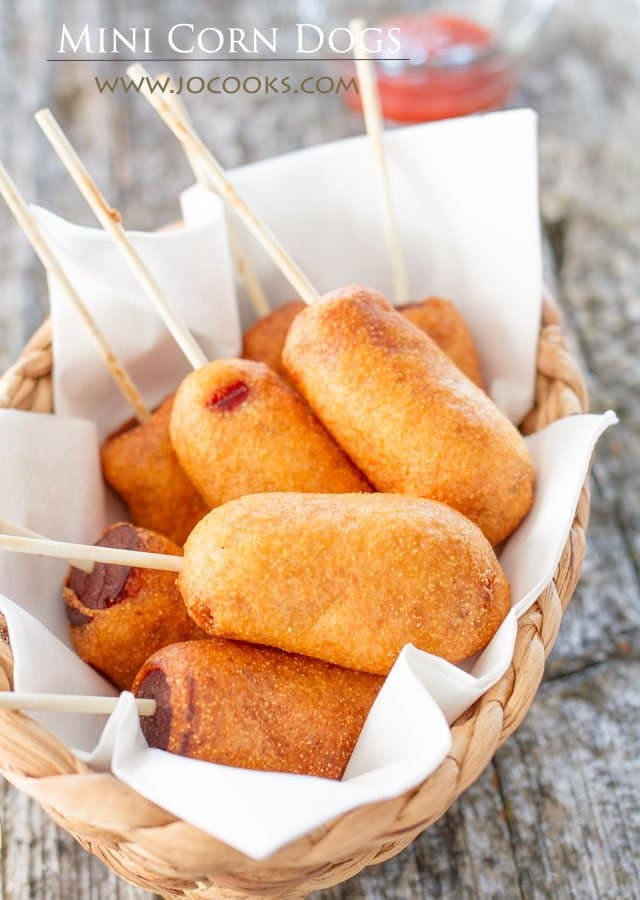 Mini Corn Dogs on lollipop sticks in a basket