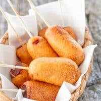 a basket full of mini corn dogs