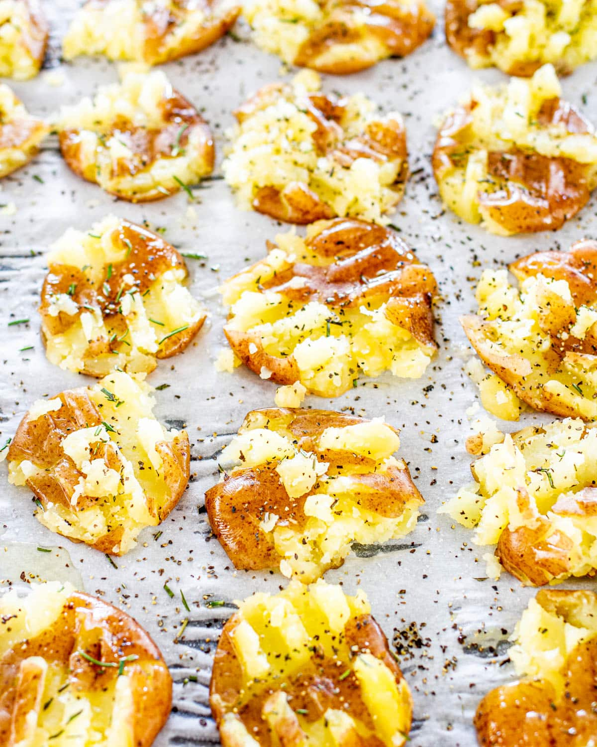 smashed potatoes on a baking sheet ready to go in the oven