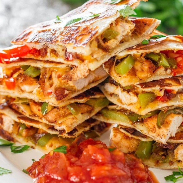 chicken fajita quesadillas on a plate with salsa
