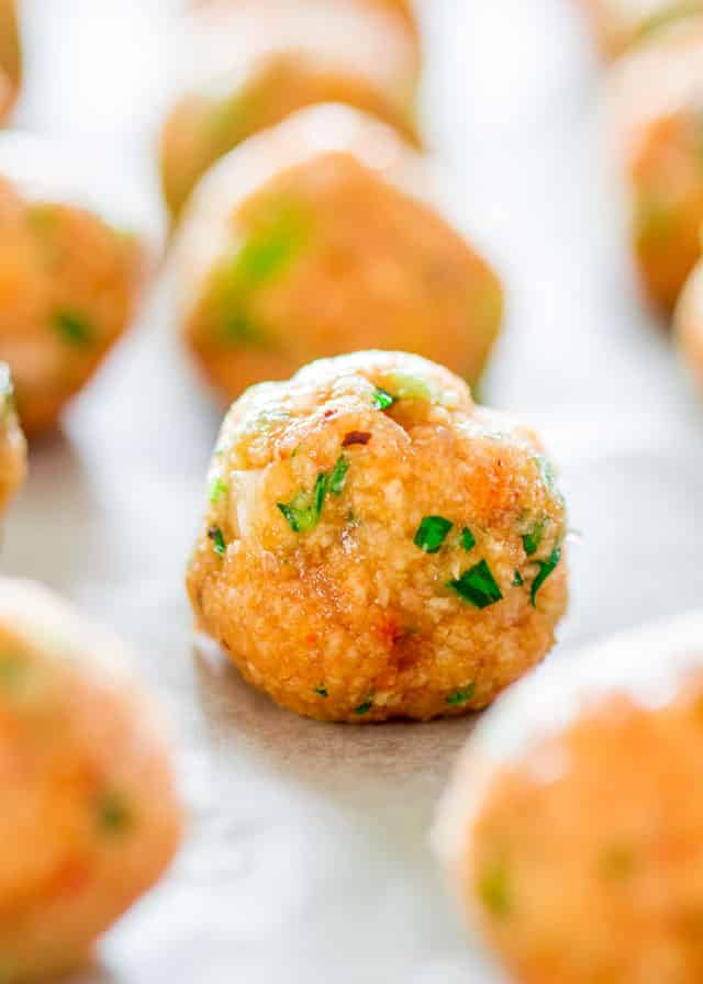 Skinny Thai Chicken Meatballs on a baking sheet before baking