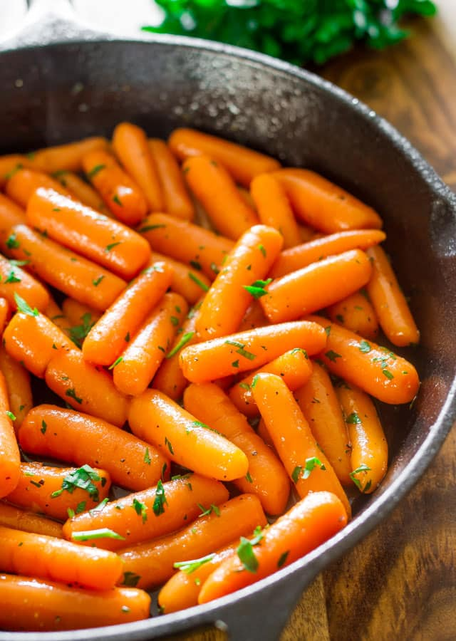 Brandy-glazed carrots in a black skillet