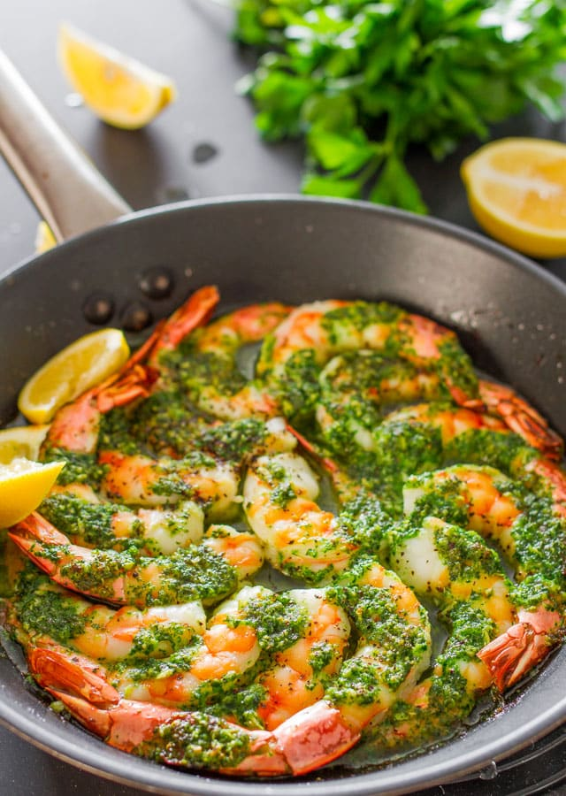 Garlic and Parsley Butter Shrimp in a skillet with a couple lemon wedges