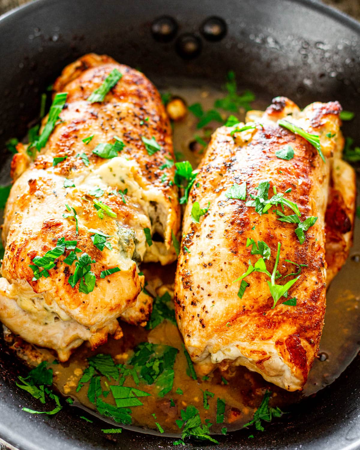 2 chicken breasts in a skillet