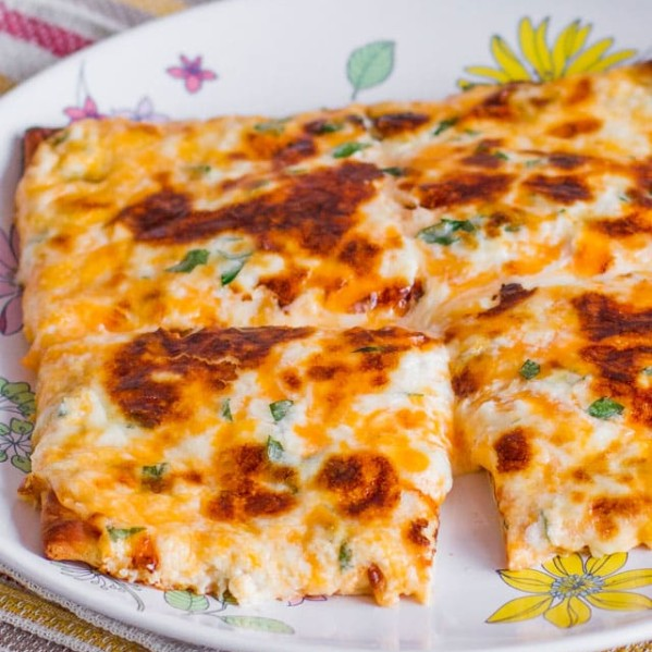 cheesy flatbread on a plate