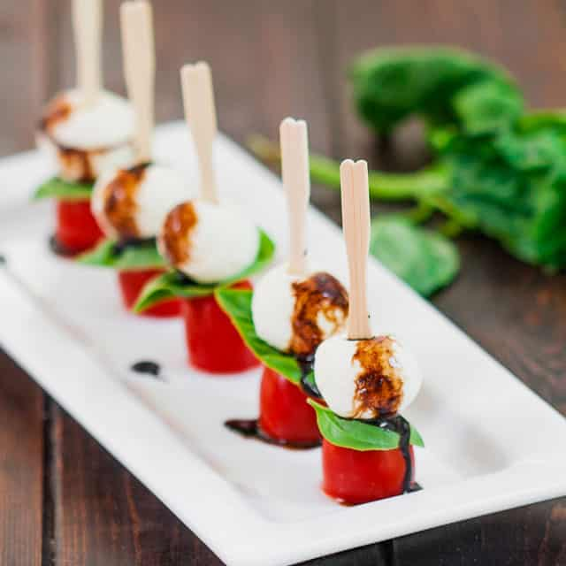 Mini Caprese Salad Bites - a most delicious salad served in a most elegant way. The perfect appetizer for a party, or just simpl