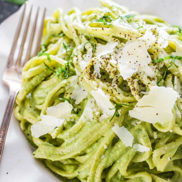 avocado and spinach pasta topped with parmesan cheese