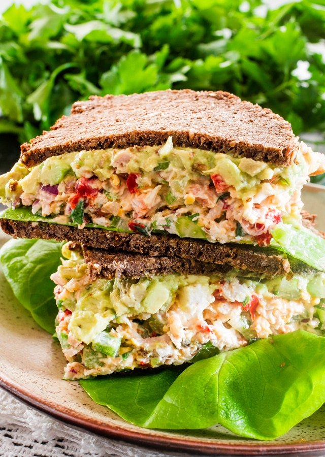 These Chicken Salad Sandwiches are loaded with the best ever chicken salad made with healthy ingredients and topped with a simple guacamole.