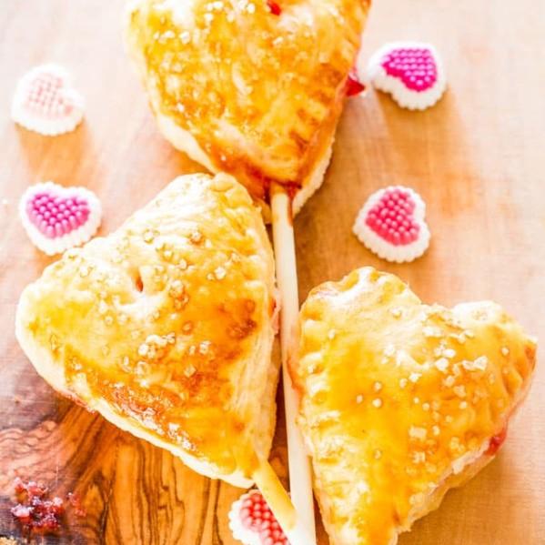 three heart shaped cherry pies on sticks