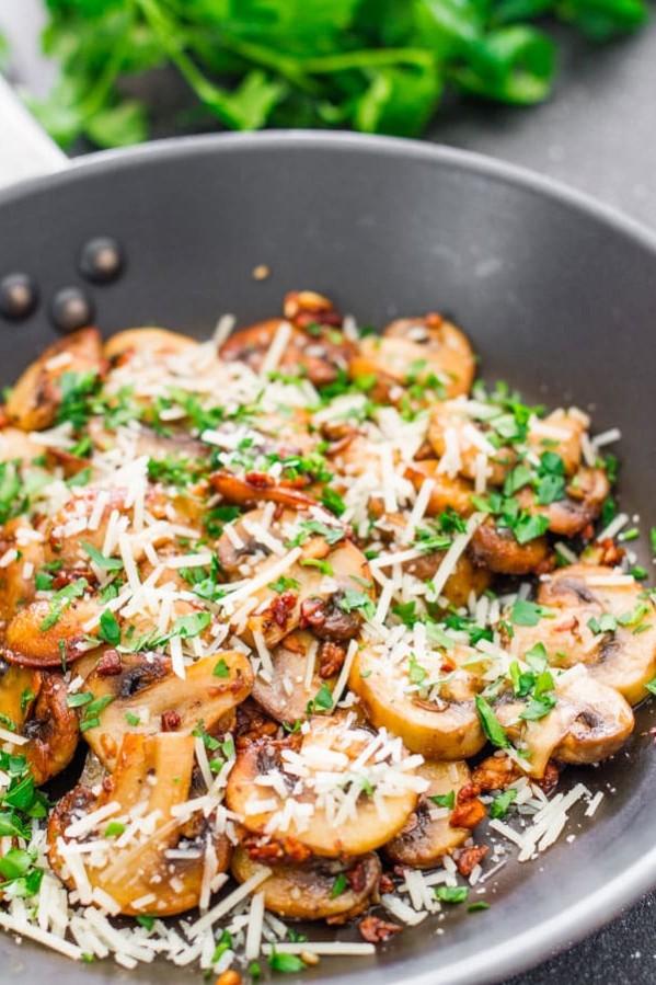sauteed garlic and parmesan mushrooms in a skillet
