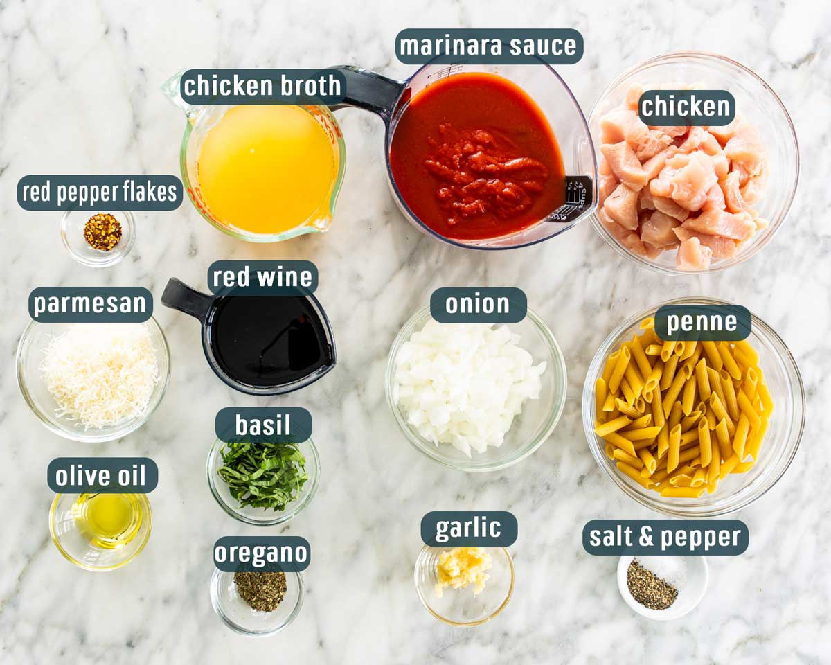 overhead shot of all the ingredients necessary to make penne arrabbiata with chicken
