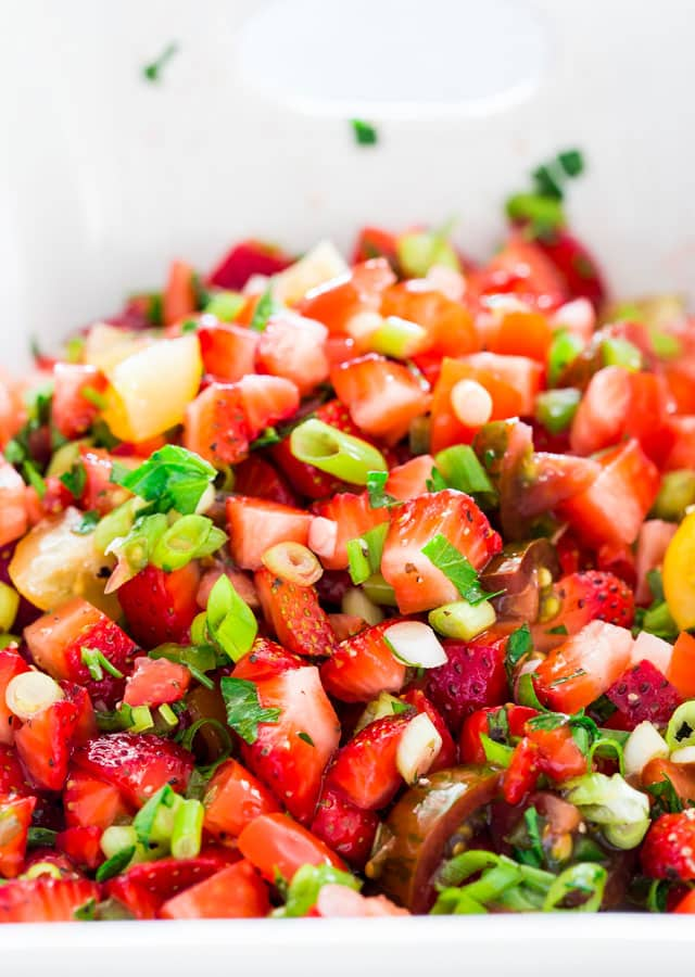 Close up of strawberry salsa with green onion on top