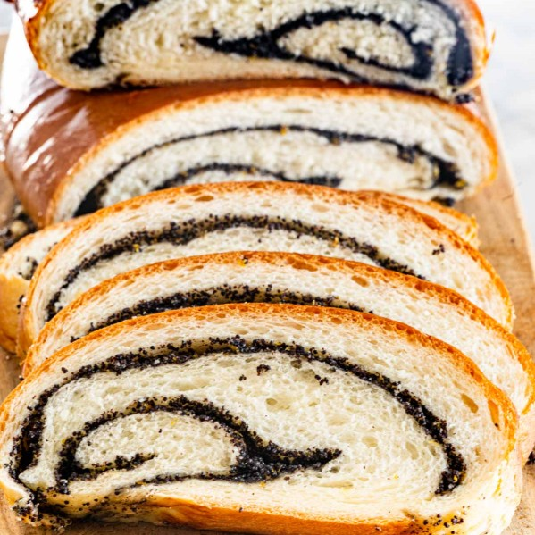 front shot of sliced poppy seed roll with the beautiful swirls exposed