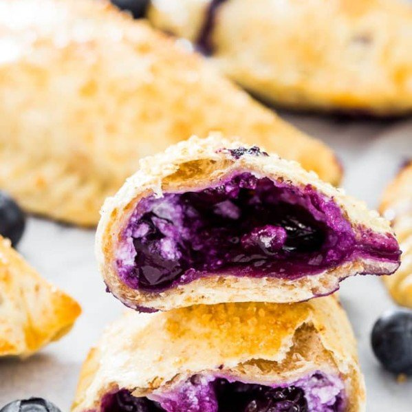 a blueberry goat cheese empanadas split in half exposing the center