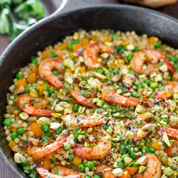 couscous with shrimp and peas in a pot