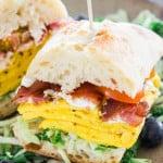 bacon omelette goat cheese ciabatta breakfast sandwich on a plate