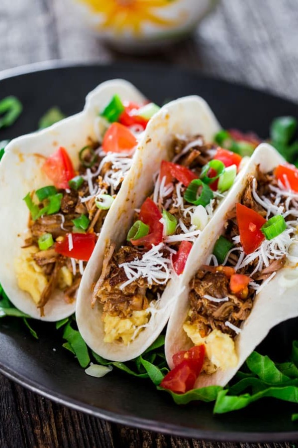 three breakfast beer braised tacos on a plate