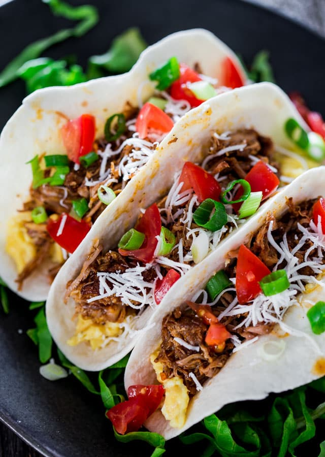 Braised Pork Tacos - This delicious slowly braised pork shoulder