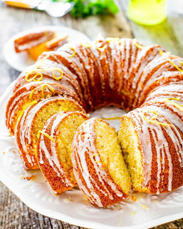 limoncello lemon cake sliced on a cake platter