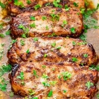 cooked mustard balsamic pork chops garnished with chopped parsley