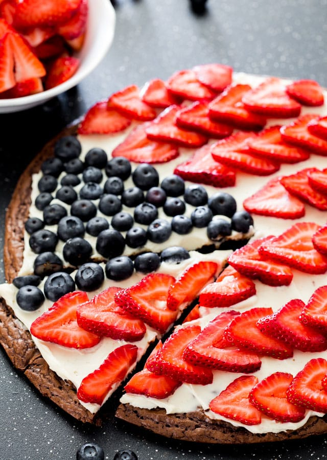 Red White and Blue Brownie Pizza on a black cutting board