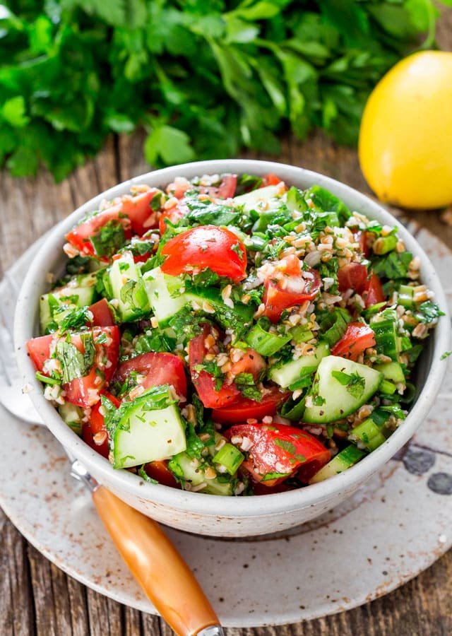 Tabbouleh Salad - a traditional refreshing tabbouleh salad featuring bulgur wheat, tomatoes, cucumber and loads of parsley and mint dressed with lemon juice and olive oil.