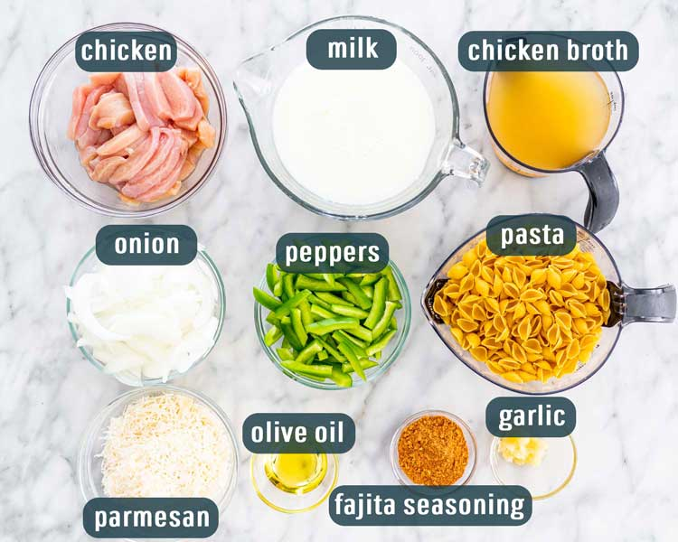 overhead shot of all the ingredients needed to make chicken fajita pasta