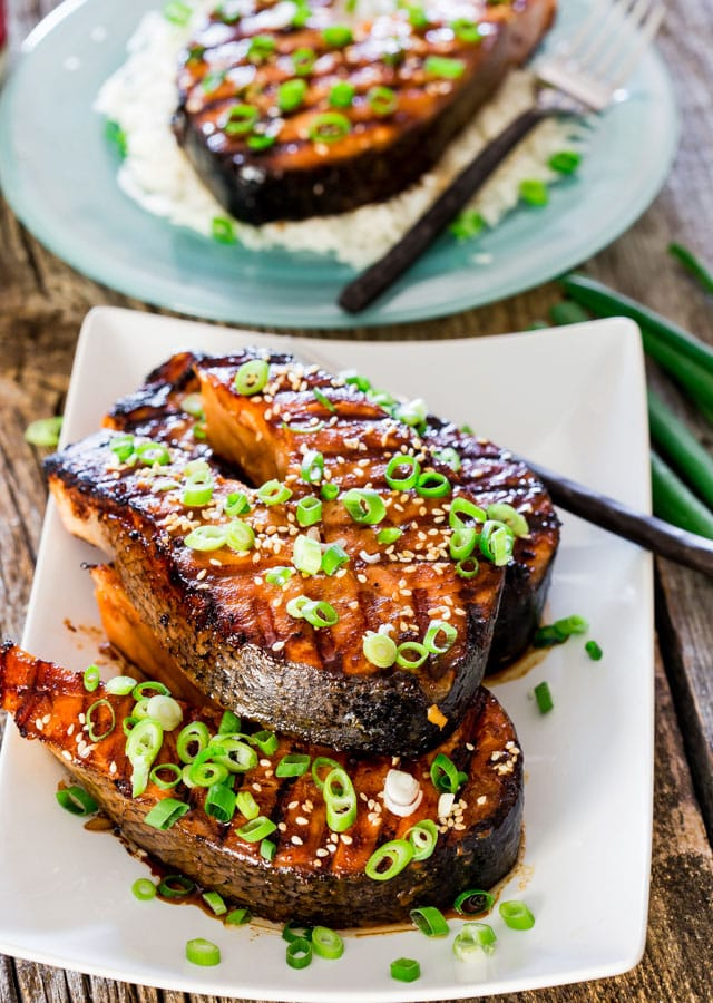 3 maple soy grilled salmon steaks on a white platter