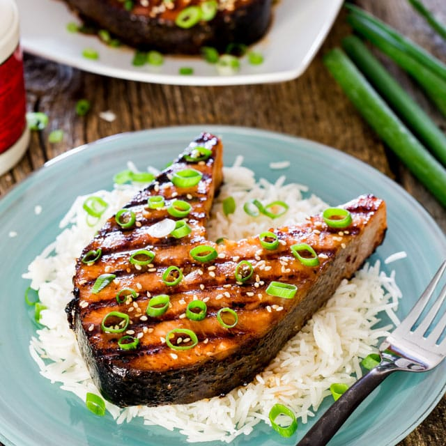 closeup of a salmon steak on a bed of rice