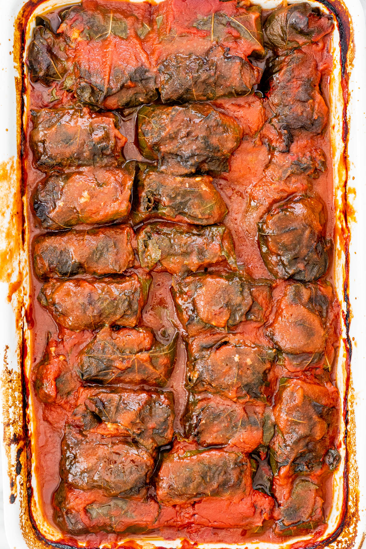 large pan with stuffed grape leaves fresh out of the oven