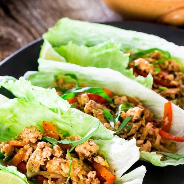 thai chicken lettuce wraps on a plate