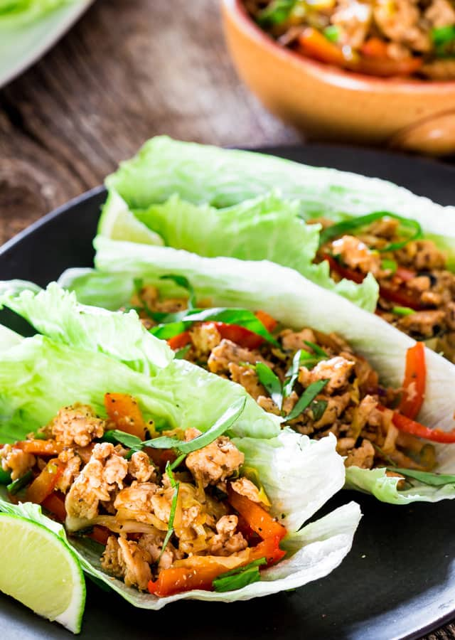 3 Thai Chicken Lettuce Wraps on a black plate