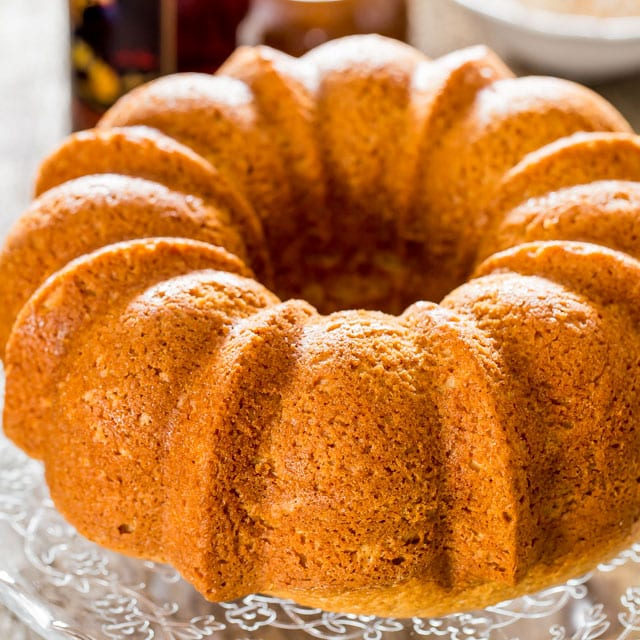 rum cake on a platter fresh out of the oven