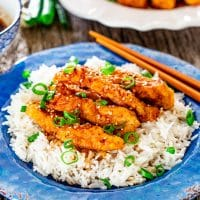 ginger chicken on top of a bed of rice