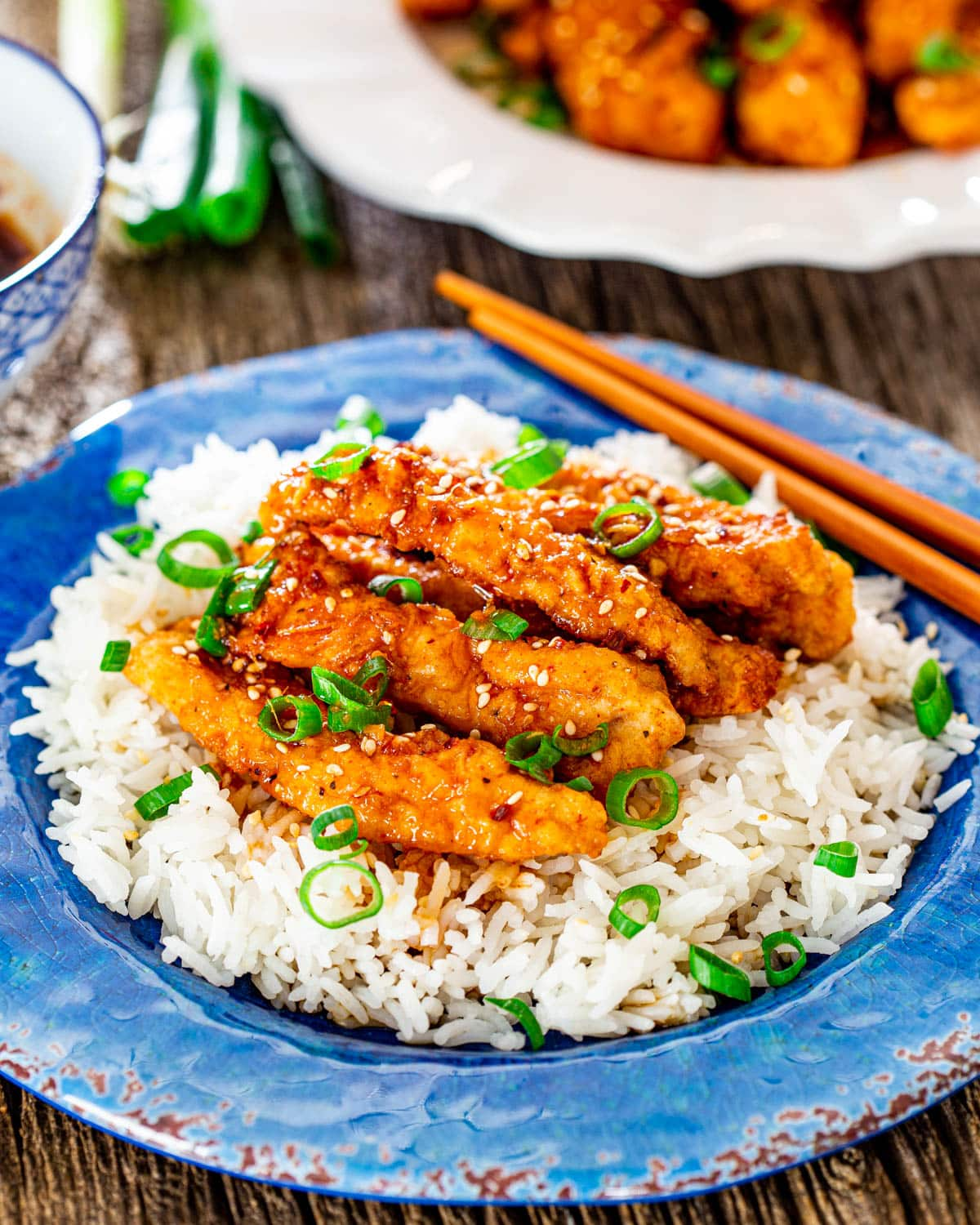 strips of ginger chicken on a bed of rice