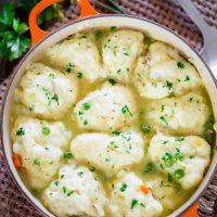 a pot full of chicken and dumplings