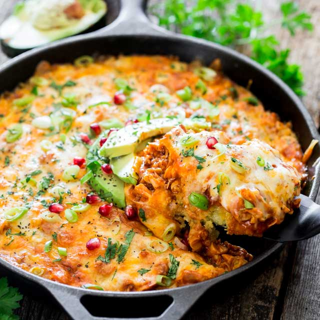 Chicken Tamale Casserole in a Skillet with a slice coming out of it