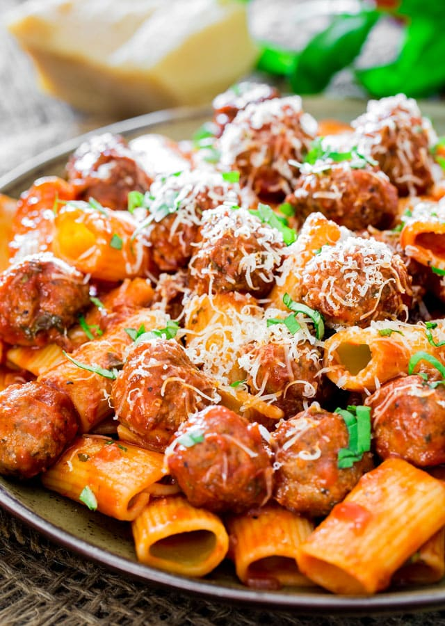 a plate loaded with Rigatoni con Polpette and Arrabiata Sauce