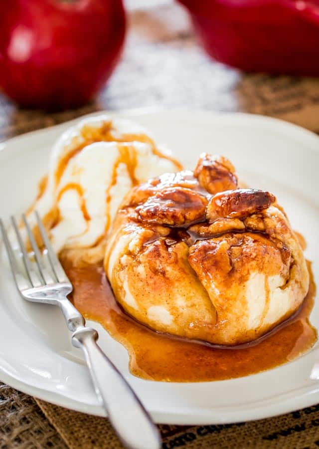 Apple Dumplings with a scoop of ice cream on a white plate