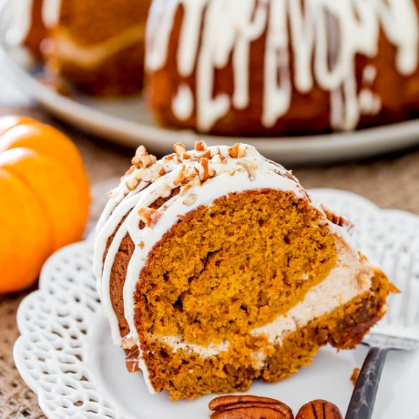 a piece of pumpkin bundt cake with cream cheese filling