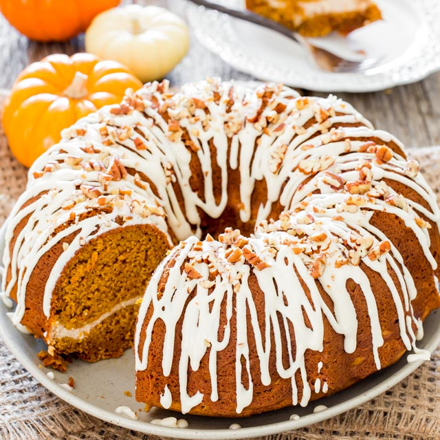 Pumpkin Bundt Cake with Cream Cheese Filling with a slice taken out