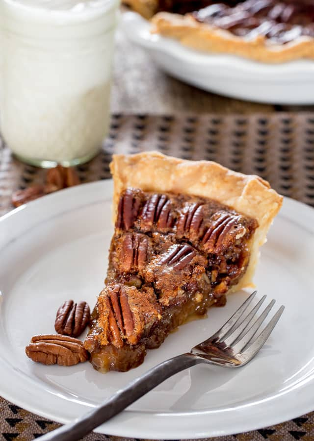 Bourbon Pecan Pie - a homemade classic pecan pie spiked with a little bourbon. A decadent, rich and delicious pecan pie, the perfect dessert for your Thanksgiving dinner.