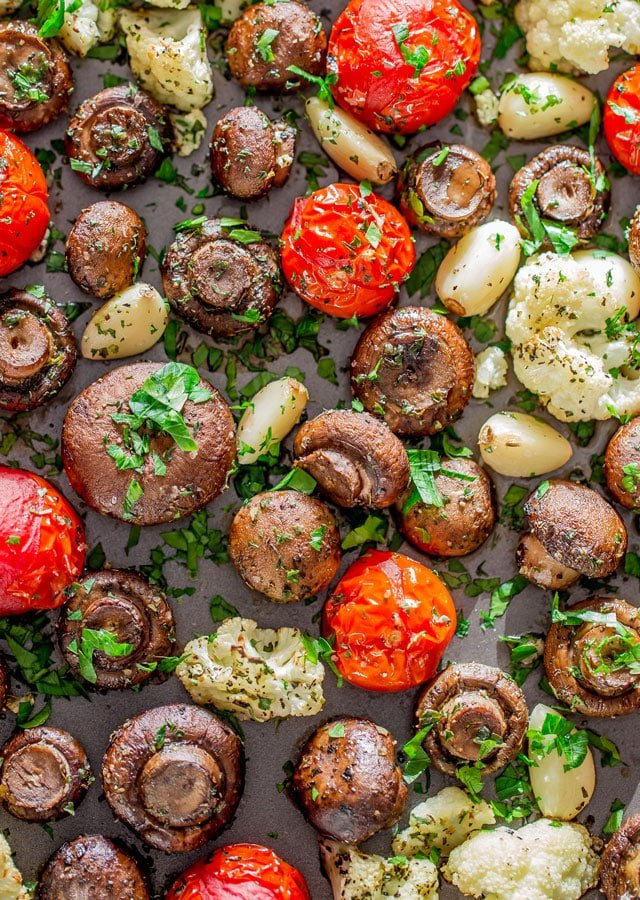 Italian Roasted Mushrooms and Veggies on a baking sheet garnished with parsley