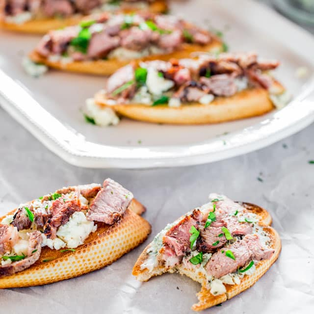 Blue Cheese and Steak Crostini with a bite taken out