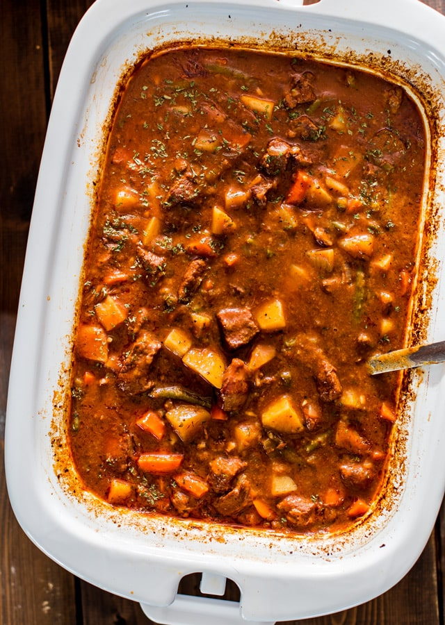 Crockpot Beef Stew in a casserole dish with a spoon