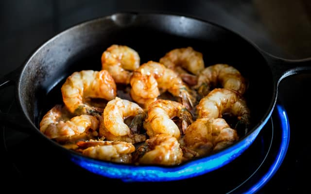 Honey Soy Shrimp cooking in a cast iron skillet