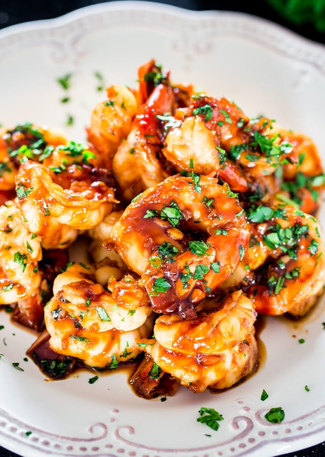 Honey Soy Shrimp on a plate topped with parsley