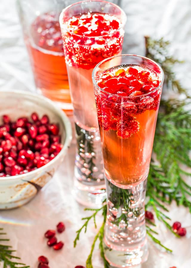 Pomegranate Elderflower Spritzers topped with pomegranate seeds