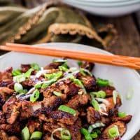a bowl of bulgogi pork with chopsticks